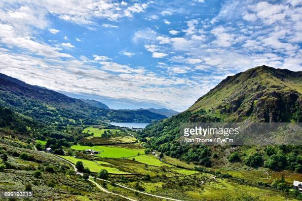 high angle view of countryside lake against mountain range - south yorkshire stock pictures, royalty-free photos & images