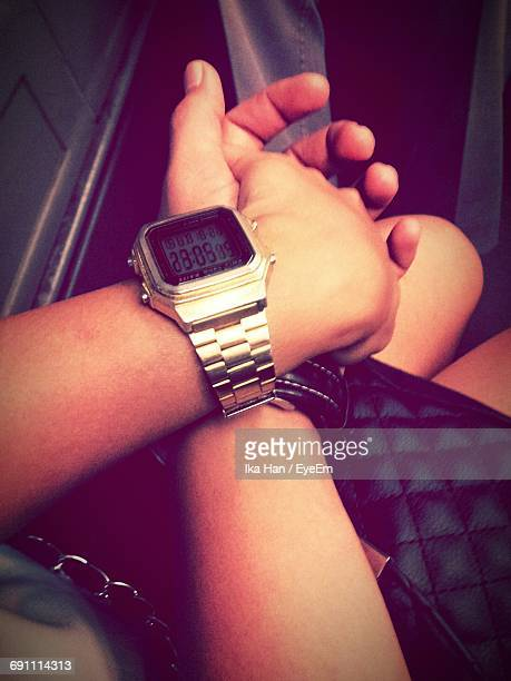 High Angle View Of Couple Holding Hands In Room