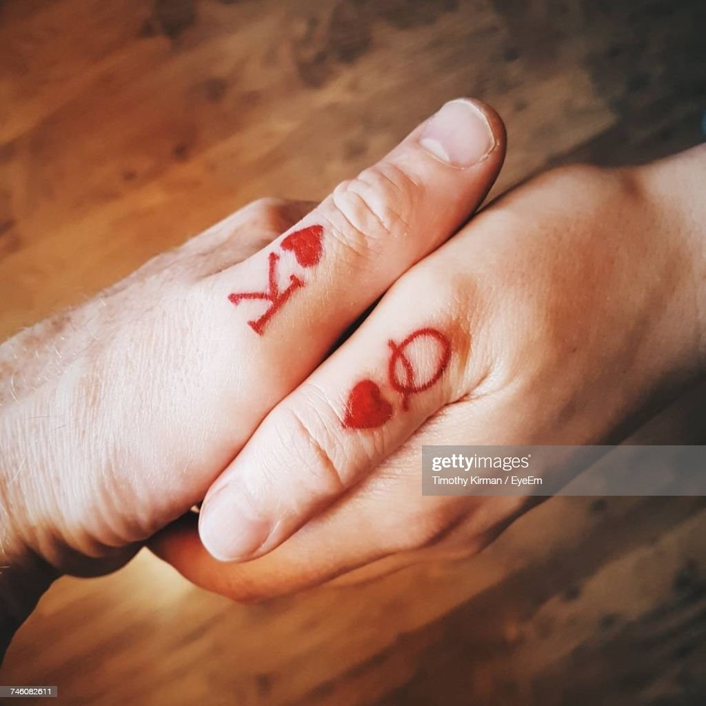 High Angle View Of Couple Holding Hands : Stock Photo