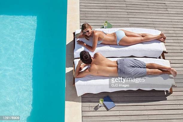 High angle view of couple resting near pool