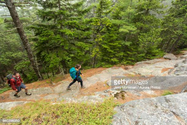High angle view of couple walking on Beach Mountain in Acadia National Park, Maine, USA