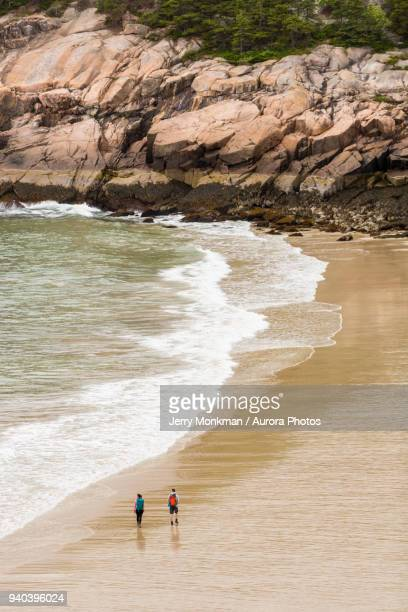 High angle view of couple walking on Sand Beach during daytime, Acadia National Park, Maine, USA