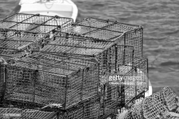high angle view of crab pots at fishing industry - crab pot stock photos and pictures