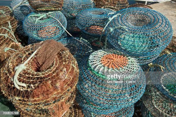 high angle view of crab pots at harbor - crab pot stock photos and pictures