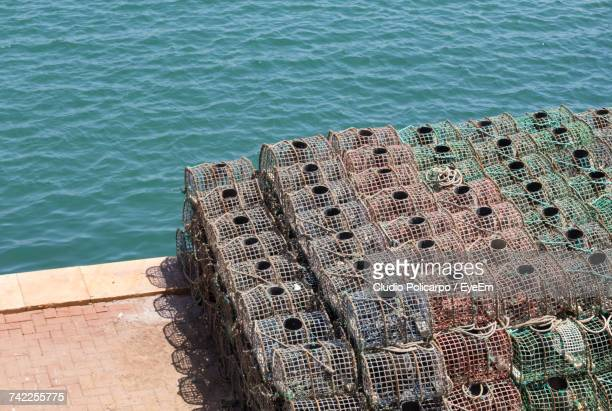 high angle view of crab pots by sea - crab pot stock photos and pictures
