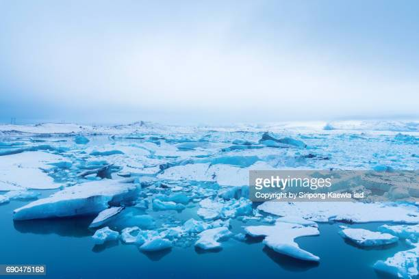 High angle view of cracked blue icebergs in glacier lake at Jökulsárlón, Iceland.