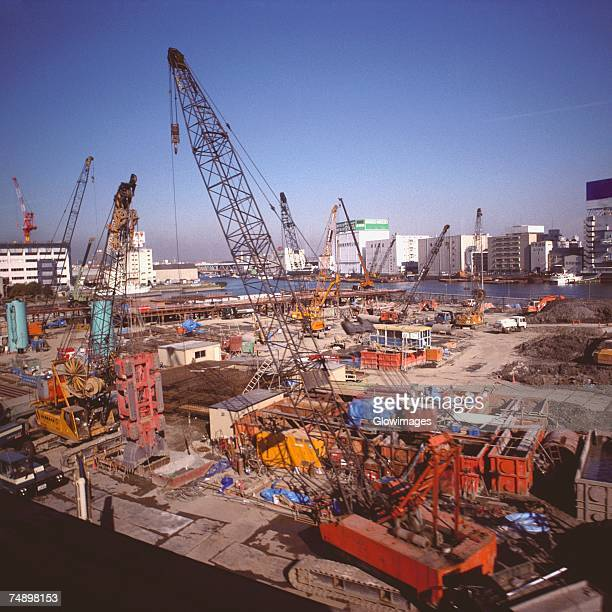 High angle view of cranes at a construction site, Tokyo Prefecture, Japan