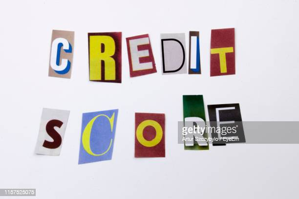 high angle view of credit score text made with colorful papers on white background - credit score stock pictures, royalty-free photos & images