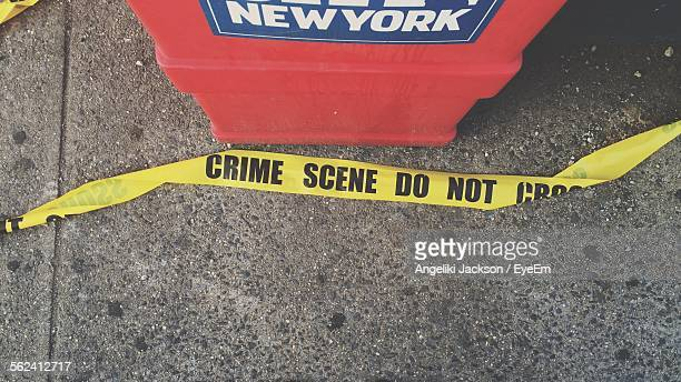 High Angle View Of Crime Scene Tape On Sidewalk
