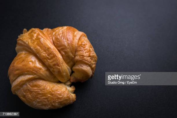 High Angle View Of Croissant Against Black Background