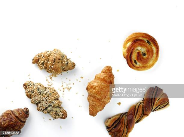 High Angle View Of Croissants And Bread Against White Background