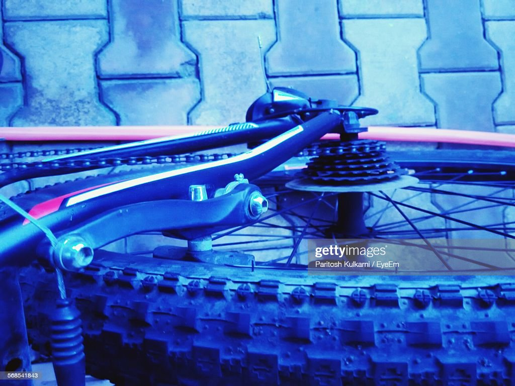 High Angle View Of Cropped Bicycle Parked On Street : Stock Photo