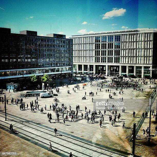High Angle View Of Crowd At Alexanderplatz Seen From Glass Window