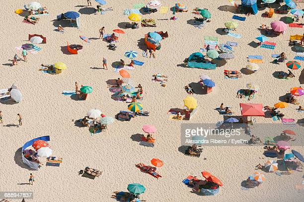 high angle view of crowd at beach - sombrilla de playa fotografías e imágenes de stock
