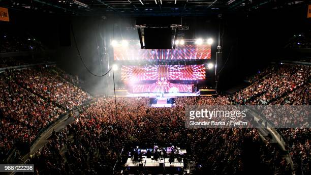 high angle view of crowd at illuminated music concert - concert stock pictures, royalty-free photos & images