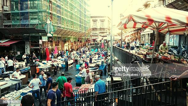 high angle view of crowd at la pescheria fish market - catania stock photos and pictures