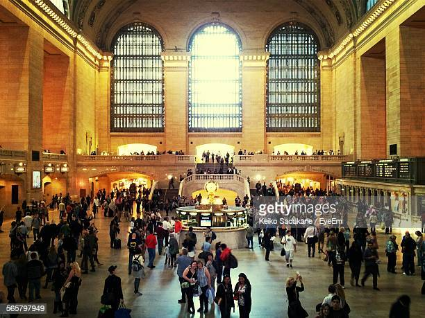 high angle view of crowd at railroad station - grand central station stock photos and pictures