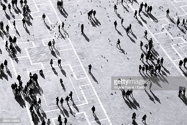 High Angle View Of Crowd At Town Square During Sunny Day