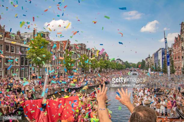 high angle view of crowd enjoying festival in city - pride stock pictures, royalty-free photos & images