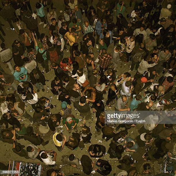 High Angle View Of Crowd Enjoying On Street During Party At Night