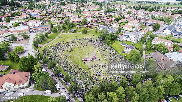 high angle view of crowd in park at town - レクサンド ストックフォトと画像