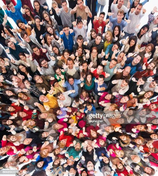 high angle view of crowd of people showing thumbs up. - crowd stock pictures, royalty-free photos & images