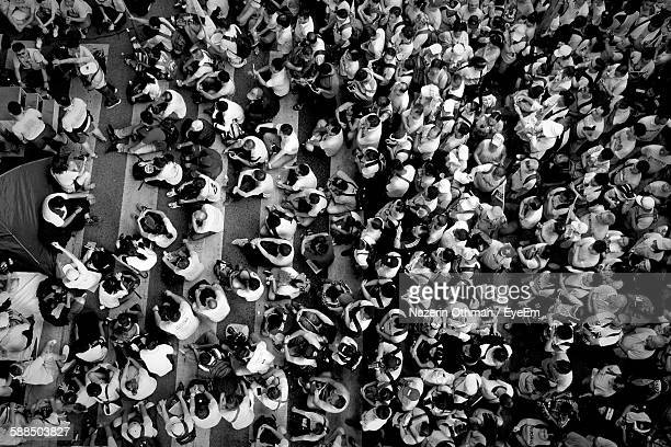 high angle view of crowd on street - manifestación fotografías e imágenes de stock