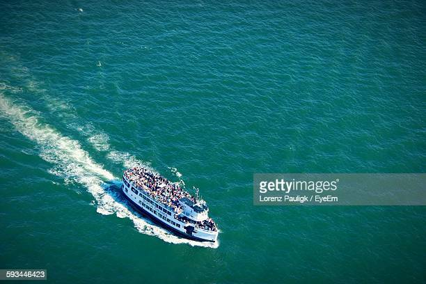 High Angle View Of Crowd Traveling On Ferry Over Sea