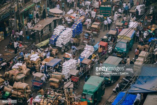 high angle view of crowded road - india market stock photos and pictures