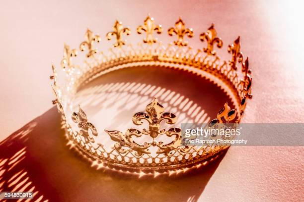 high angle view of crown and shadow - royal stock photos and pictures