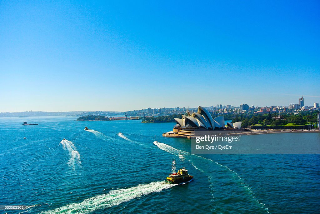 High Angle View Of Cruise Next To Opera House Against Clear Sky : Stock Photo