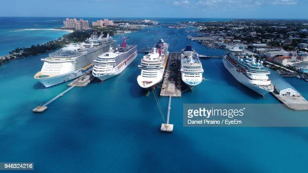 high angle view of cruise ships moored in sea against blue sky - cruise ship stock pictures, royalty-free photos & images