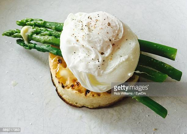 High Angle View Of Crumpet And Poached Egg In Plate