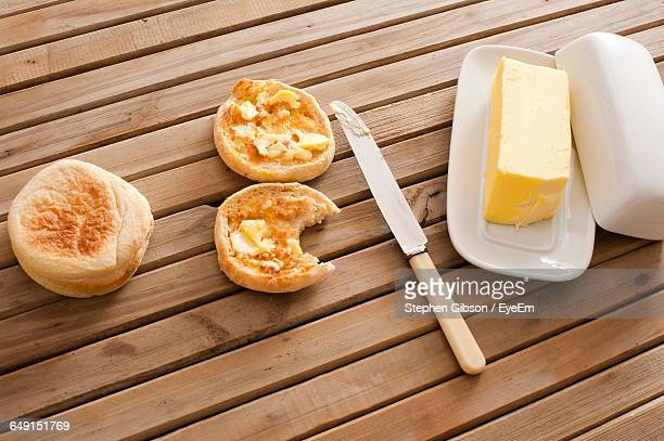 High Angle View Of Crumpets With Butter On Table