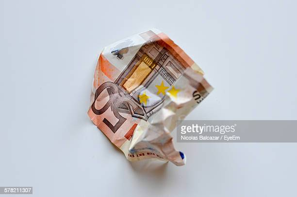 High Angle View Of Crumpled Fifty Euro Banknote