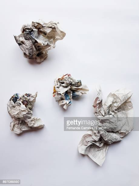 High Angle View Of Crumpled Newspapers On White Table