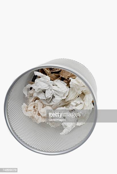 High angle view of crumpled paper in a wastepaper basket