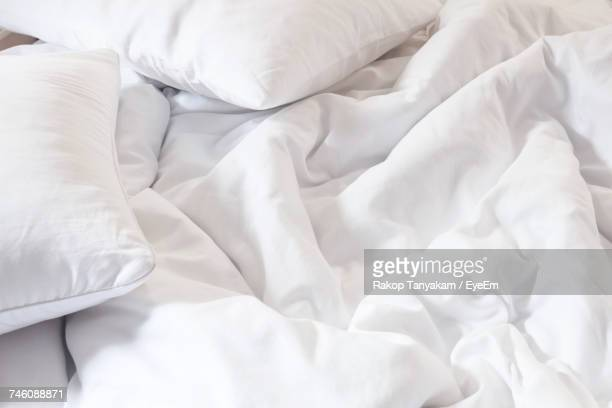 high angle view of crumpled sheet on bed at home - bedclothes stock pictures, royalty-free photos & images