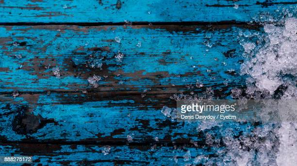 high angle view of crushed ice on blue wooden table - crushed ice stock pictures, royalty-free photos & images