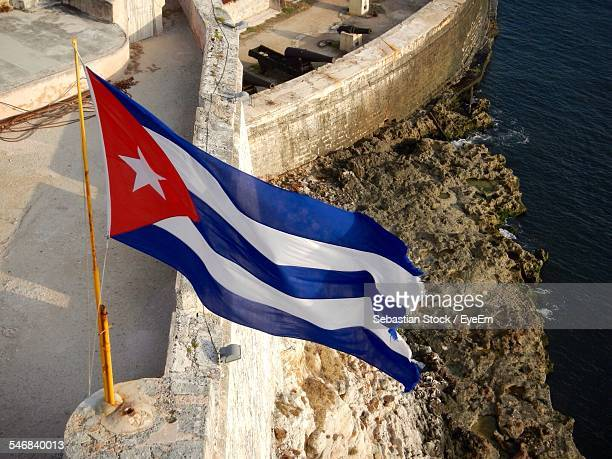high angle view of cuban flag by river - cuban flag stock pictures, royalty-free photos & images