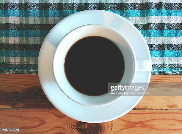 High Angle View Of Cup Of Black Tea On Table