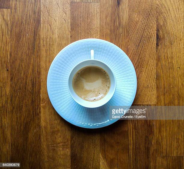 High Angle View Of Cup Of Tea On Table