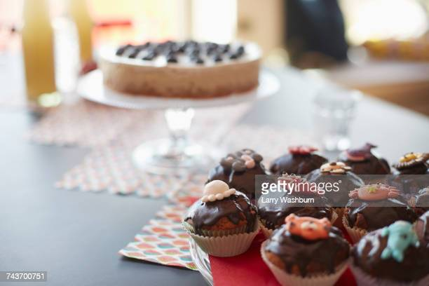 High angle view of cupcakes on stand at dining table