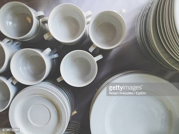 High Angle View Of Cups And Empty Plates On Table