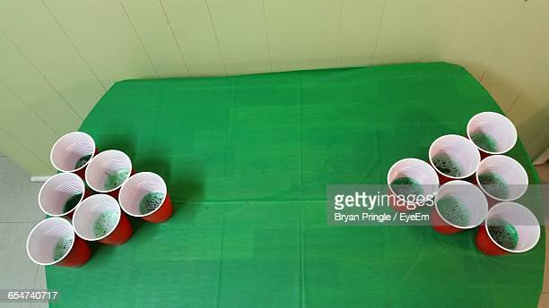 High Angle View Of Cups Arranged On Table For Beer Pong
