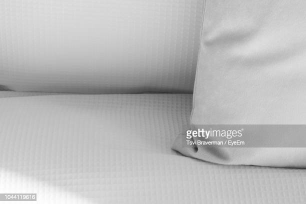 high angle view of cushion on sofa - cushion stock pictures, royalty-free photos & images