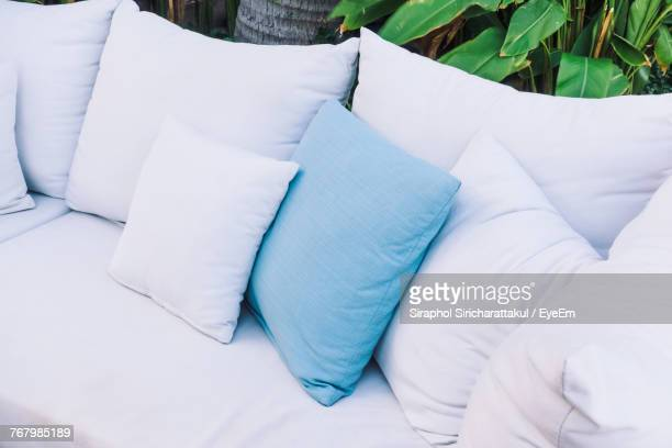 high angle view of cushions on sofa at back yard - cushion stock photos and pictures