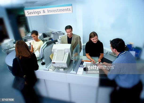 high angle view of customers and employees at a bank