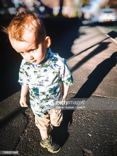 high angle view of cute baby on road - one baby boy only stock pictures, royalty-free photos & images