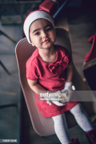 High Angle View Of Cute Little Christmas Baby Girl Sitting On a Chair